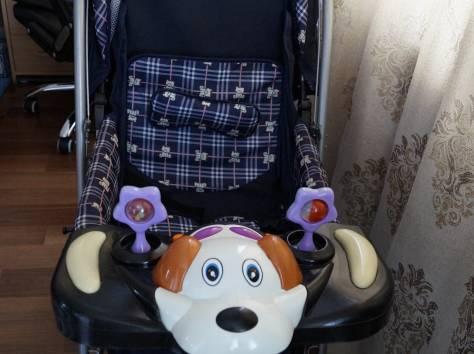 Продам прогулочную коляску с перекидной ручкой б/у, фотография 1