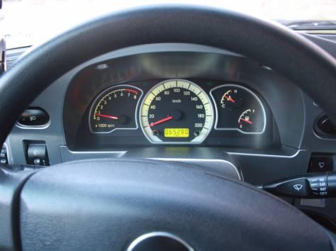 Daewoo Nexia серебряный седан, 2010 г., пробег 65 000 км., фотография 7