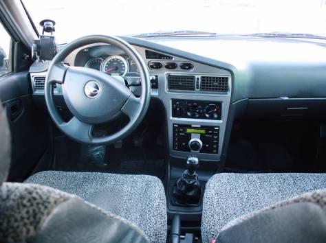Daewoo Nexia серебряный седан, 2010 г., пробег 65 000 км., фотография 8