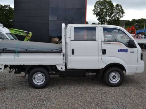 KIA Bongo III 2х кабинный,грузо-бортовой.Новый.Кредит,лизинг., фотография 2