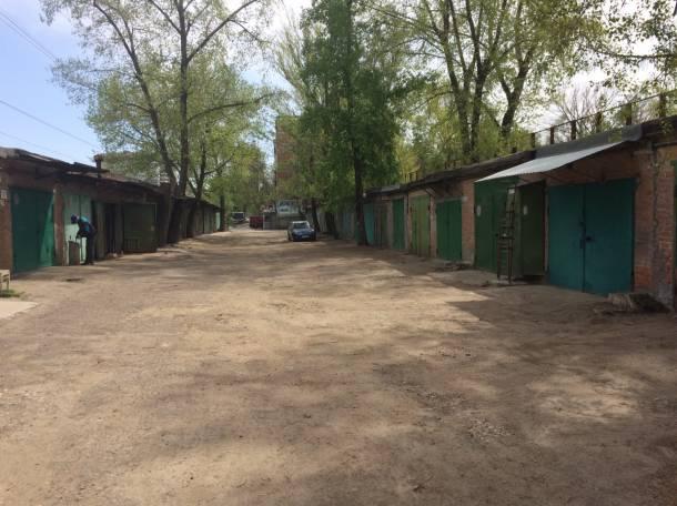 Продам охраняемый кирпичный гараж 18 м², фотография 1