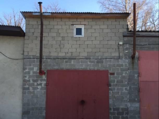 Сдаю охраняемый железобетонный гараж 50 кв. м., фотография 1
